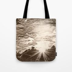 Castle at sundown (Antiqued) Tote Bag I'm starting a series of antique looking pics. This is the first one, Trifels castle on a sundown in winter.   Landscape, sepia, castle, sky, clouds, sunbeams, Germany, grass, mountain, tree, wrinkle, black, sunrays, silhouettes  That's a similar pic, but more colorful:  https://society6.com/product/golden-ages_print#1=45
