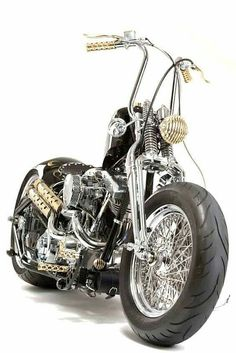 Shovelhead hardtail custom with fat rear tire,  modern rubber,  springer front end and brass accents