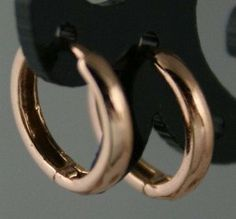 Rare 1.26g Classic Style Solid 14K Pink Rose Gold Huggies Hoop Earrings 12x3mm Totalheaven. $131.00. Hallmarked. Genuine Solid 14K Plumb Gold. Made in USA. Hypoallergenic