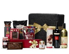 Our Midnight Feast gift hamper has a touch of class about it! Lots of delectable goodies from cheese and chutney to cake and chocolates, and wine to wash it down...brought to you in a lovely wheatbraid basket to use for storage. Ideal as a gift for customers or staff...or family and friends!