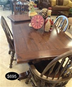 Rich rustic mahogany trestle table. Complete with 4 chairs, 2 leafs, and custom table pads.  Yesterdays Treasures Consignment  5829 Lone Tree Way Suite J   Antioch  925 - 233 - 4547  www.Yesterdayststore.com  Info@Yesterdayststore.com