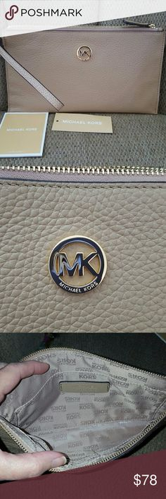 "MICHAEL KORS LARGE ZIP CLUTCH/WRISTLET New with tags.   AUTHENTIC LEATHER Fulton Dark Camel    Large zip clutch.  Can be used as a wristlet or    Slim bag to hold items inside purse or not  9 3/4"" wide x 5 1/2"" tall Michael Kors Bags Clutches & Wristlets"