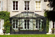 Photo : véranda avec toiture en verre double vitrage