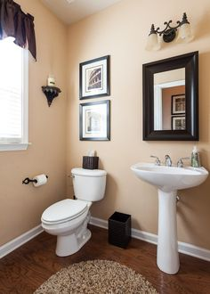 Find This Pin And More On Bathrooms Traditional Powder Room With Hardwood Floors Pedestal Sink