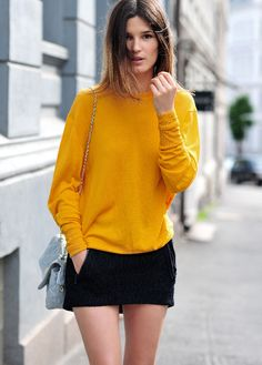 Sweater and skirt is by Acne and bag by Mulberry.