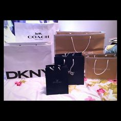 Assorted Designer Gift Bags Assorted Designer Gift Bags Michael Kors,DKNY,Swarovski,Coach I have multiples of some, please ask.  Individual or bundle purchase Available Michael Kors Bags