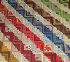 multi-colored Log Cabin Straight Furrows quilt from Artisans Center of Virginia.