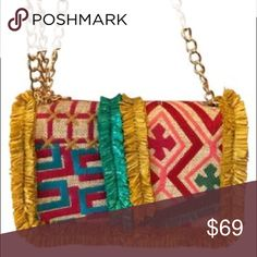 """Nanette Lepore Multi Color Crossbody Bag Chic Nanette Lepore tribal style gold chain shoulder bag. NWOT. Measures 8""""L x 5.5W x 3""""D. Chain drop 23"""" Fully lined, includes zip compartment and magnetic closure. Nanette Lepore Bags Crossbody Bags"""