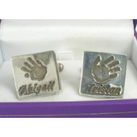 Handprint cufflinks! Actual childrens prints shrunk down and set into fine silver cufflinks! The perfect gift for fathers day!