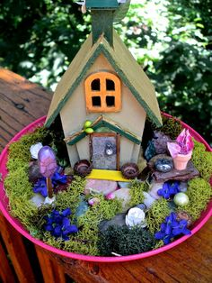 Cute little fairy cottage and garden. The cottage is painted peridot green with gold trim and gold roof. The front door has a swarovski crystal