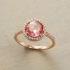 24 pretty engagement rings under $1,000, including this pink beauty