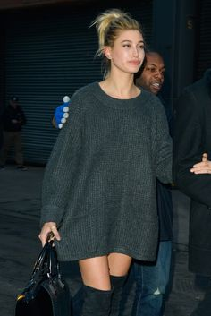 Hailey Baldwin wins casj date night style in over the knee boots and cosy jumper dress