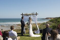 Rustic and Boho Beachside Wedding + whites roses and baby's breath matched their theme