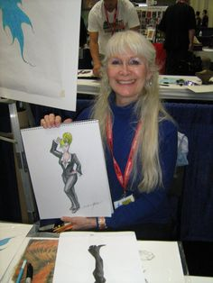 Happy Birthday, Barbara Marker! Marker started working as a comic book artist in 1981. She was hired to color cover art but sometimes did the entire process, the drawing, inking and color. She worked for 12 years for Pacific Comics, Blackthorne Publishing, DC Comics, Eclipse Comics, and Dark Horse Comics. (11/26)