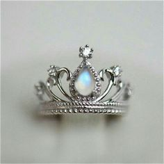No crown on her head to indicate her royalty the.Hope sees her ring