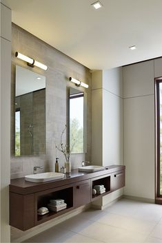 Traditional and contemporary design blend seamlessly in the Lynk 24 bath light from LBL Lighting. A sleek metal band and matching die cast end caps embrace the rounded shade, while advanced LEDs provides superior light quality.