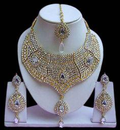 White Stone Studded #Necklace Set @ $44.73 | Shop @ http://www.utsavfashion.com/store/item.aspx?icode=jnc2355