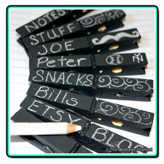 Chalkboard painted clothespins.
