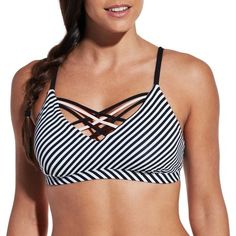 Get the best of both worlds in the CALIA™ by Carrie Underwood Front Strappy Bikini Top. Sporty style meets trendy design in this classic swim top. Featuring a criss cross design with multiple straps on the front, a fun stripe print compliments the classic silhouette. Fully lined for ultimate coverage, create a custom fit with adjustable straps and removable pads. Bring on beach season in style with CALIA™ by Carrie Underwood.