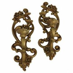 """Perfect displayed in your dining room or master suite, this vintage burlwood candle sconce showcases ornate scrolling details and a golden finish. Marked """"Homco MCMLXXI Made in USA 4118.""""  Product: Set of 2 candle sconcesConstruction Material: Resin and burl woodColor"""