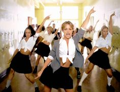 1998 - Britney Spears in her video for her first smash hit, Hit me baby one more time.