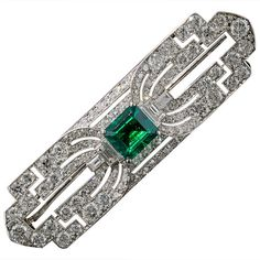 Art Deco Fine Gem Emerald Diamond Platinum Brooch | From a unique collection of vintage brooches at https://www.1stdibs.com/jewelry/brooches/brooches/