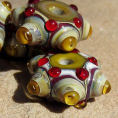 This is set of 4 lampwork glass bubble window beads in amber and honey with bright red accent dots.