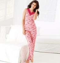 Rose-Tinted Pajama Set in Misses. Say goodnight in style in this cozy pajama set of light rose pink with dark red and rose colored floral prints. Top features a v-neck with red mesh trim/lace on collar. Full length pants feature an elastic waist band. www.youravon.com/rhonda-kaczmarek