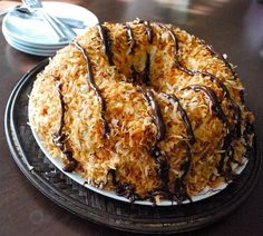 Does this cake look like a familiar cookie to you? A Samoa perhaps? That's exactly what it tastes like, too: a Samoa in cake form. It's positively sinful.