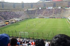 Football Match – Lima, Peru. To many South Americans, Soccer or Futbol is a way of life. Peru is no exception. Estadio Monumental in the capital city of Lima sometimes hosts the national team, commonly known as La Blanquirroja (the red and white). With a capacity of over 80,000, it is one of the largest stadiums on the continent. Click photo to play authentic sound from www.thetouchofsound.com.