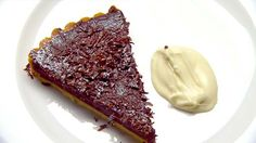 Chocolate tart-Recipe by: Marco Pierre White-Serves: Serves: 8 as a dessert-163 votes- Dough : Butter and four for greasing 200g butter 80g icing sugar 2 egg yolks 300g plain flour A little iced waterFilling : 350ml thickened cream 150ml milk 3 whole eggs, lightly beaten 500g Valrhona 70% Guanaja Garnish: 200g dollop cream 100g Valrona 70% Guanaja dark chocolate, finely grated-http://tenplay.com.au/channel-ten/masterchef/recipes/chocolate-tart