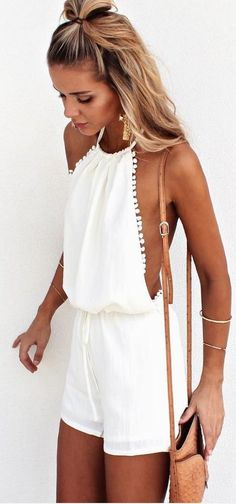 Love everything about this boho outfit.The white play suit, the classic jewelry and the simple hair!