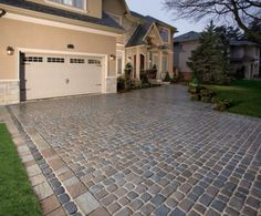 Driveway by Unilock with Richcliff and Courtstone paver. Like this for the walkway, maybe only one row of trim (squarish blocks)