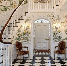 Gorgeous foyer with classic black & white ffloor and that wallpaper - stunning!