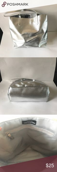 Bloomingdales Silver Tote Stylish Tote - perfect for running errands and overnight getaways.  Polyester Lining. 100 % man made.  Never worn.  13 inches long, 17 inches wide, bottom panel = 6 inches, handle drop = 10 inches. 1 inside zipper. Excellent condition. NWOT Bloomingdale's Bags Totes