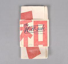 hill-side woodblock print square pocket: 100% charitable donation.