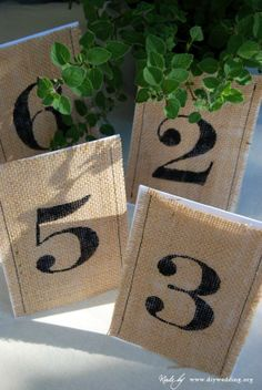 Add a vintage touch to your wedding with these DIY burlap table numbers.