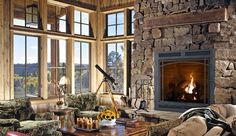 Wood Fireplace instead.  Keep it nice and high off the ground.  Just add fire log nook in stone fireplace and I'm there!!!   Also, Like the simplicity of the windows and grids.