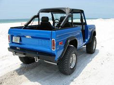 All sexy guys should have an old bronco to drive around the beach