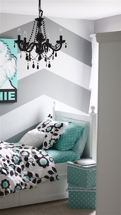 Gorgeous girl bedroom with chevron wall and turquoise polka dots and floral patterned bedding