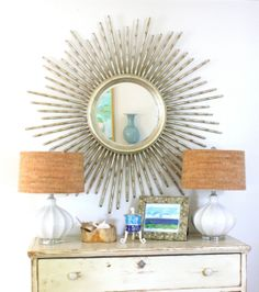 I love this table with the lamps and if I don't find a great sunburst mirror pretty soon, I am going to flip! I am in love with these things.