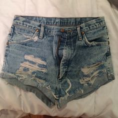 Wrangler Cut off shorts Great condition high wasted shorts. Bought them off of here but they never fit so reselling. Dimensions are 31x36 Wrangler Shorts Jean Shorts