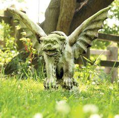 Gargoyle statue. Wonder if it would keep those pesky raccoons off my deck!