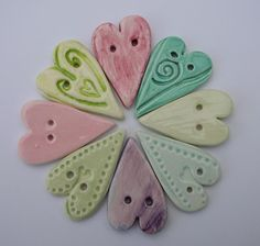Google Image Result for http://www.kathygoodridgestudioceramics.com/photos/Decorative-Hangings/web%2520large%2520heart%2520buttons.JPG