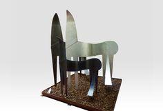 Modern three horses sculpture called Equivoci.