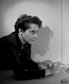Photo by Fred Stein. Portrait of Hannah Arendt wearing a dark collar shirt leaning over an ashtray Hannah Arendt, Jüdisches Museum, Berlin Museum, Mary Mccarthy, Short Term Goals, Portraits, Human Condition, Street Photographers, Loneliness