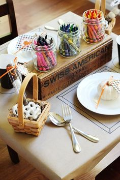 Activities at the children's table to keep the little guests occupied all night long, love this idea