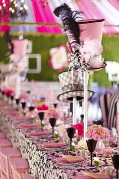 Hat decor: I love these colors, the fun, the hats!!  Feels like a mad hatter tea party!  I need a reason to set up these type of decorations