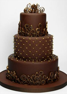 Beautiful chocolate brown cake with gold quilting accents and chocolate/metalic scroll work