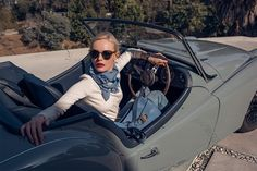 Kate Bosworth wears Tory Burch Iberia Cashmere Sweater, Gemini Link Striped Oblong Scarf, Gemini Link Shoulder Bag and Collins Double-Wrap Watch, Navy Leather/Gold-Tone, 32 Mm